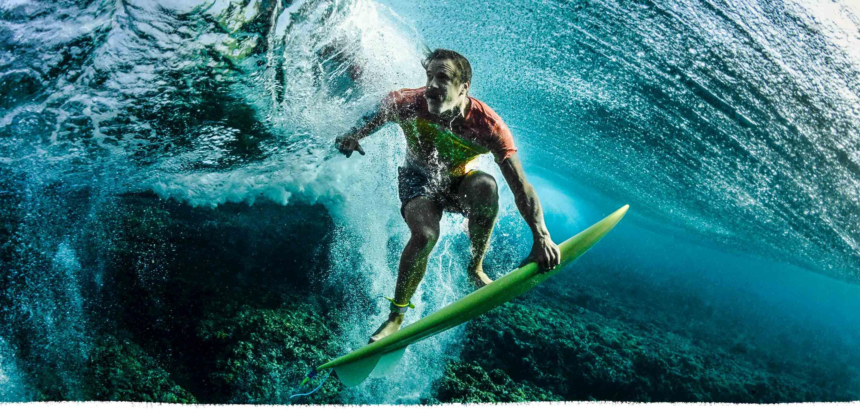 guy surfing underwater