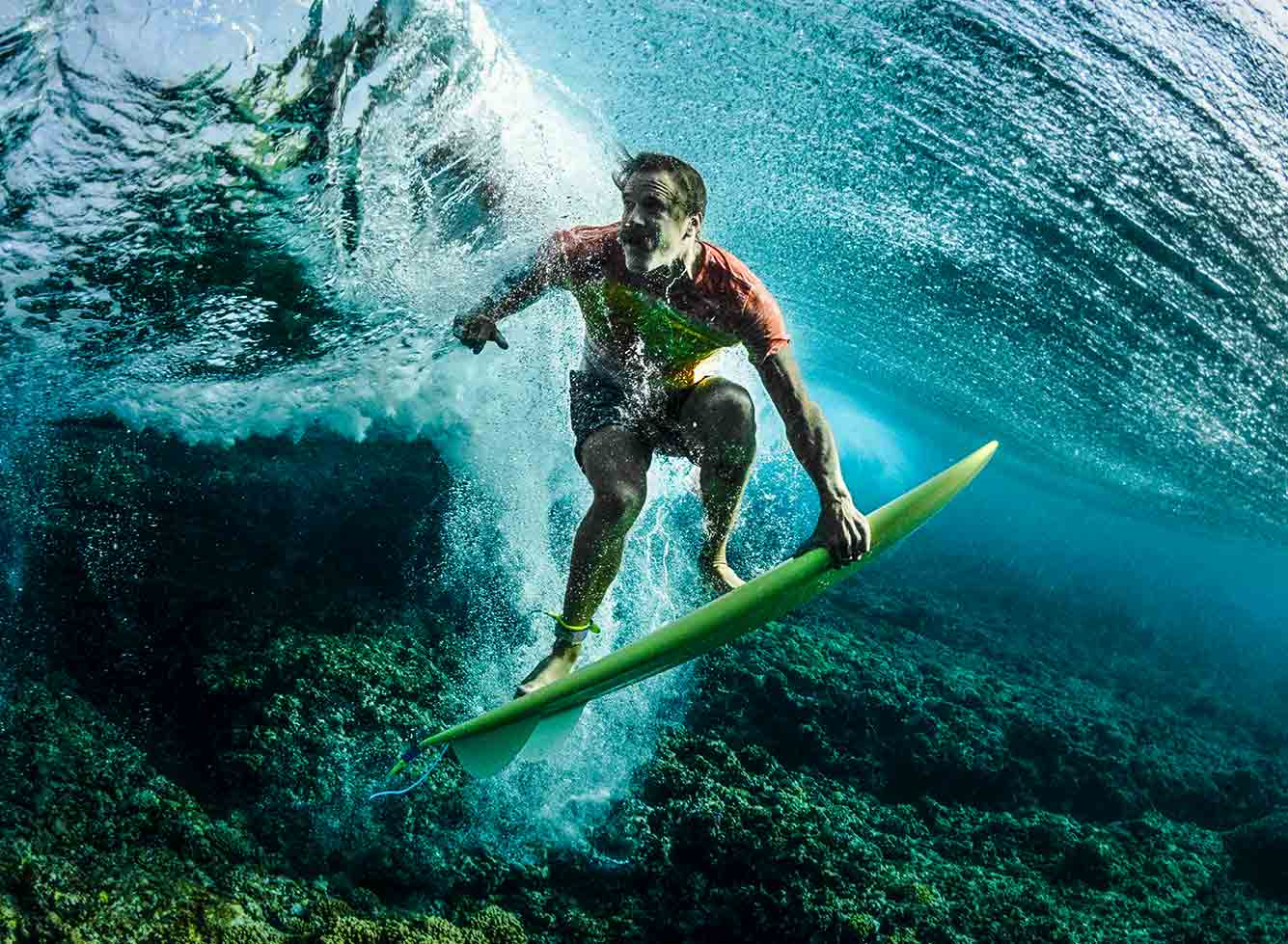 guy surfing underwater