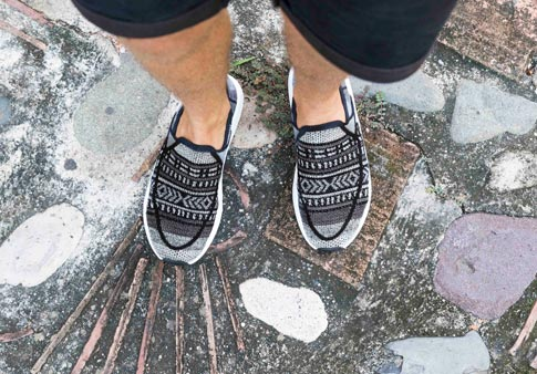 f02ea24c8c28 Man wearing Chiba Quest Knit shoe while standing on a decorative stone  floor.