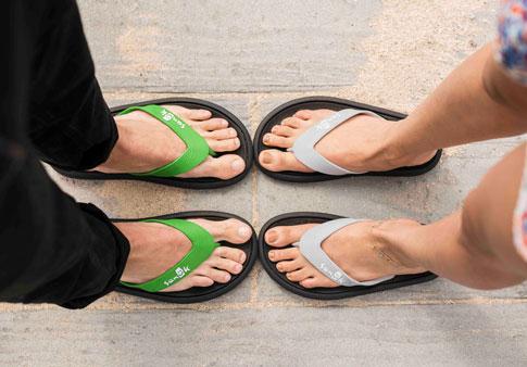 144ea305cd8 Man and woman wearing Sidewalker sandals.