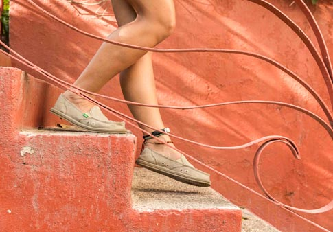 22d06f74653 Woman wearing Donna Hemp shoe while walking down stairs.
