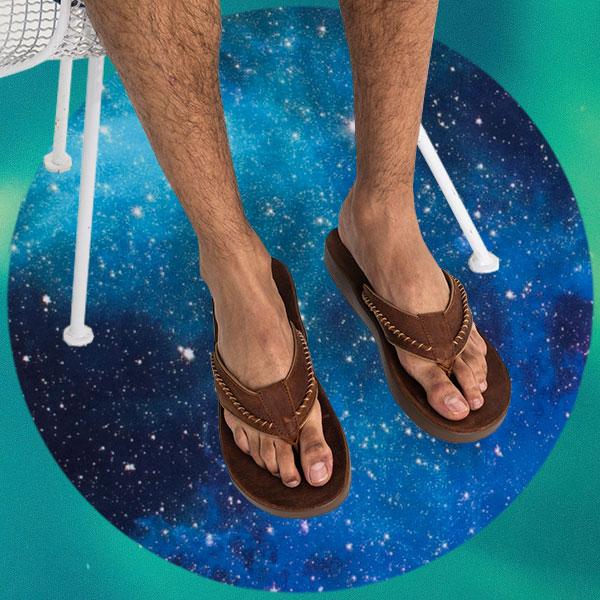 Close up of someone's feet wearing Sanuk Yoga Comfort Sandals.