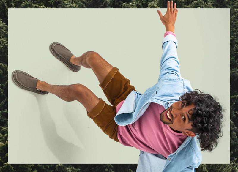 A person wearing Sanuk shoes.