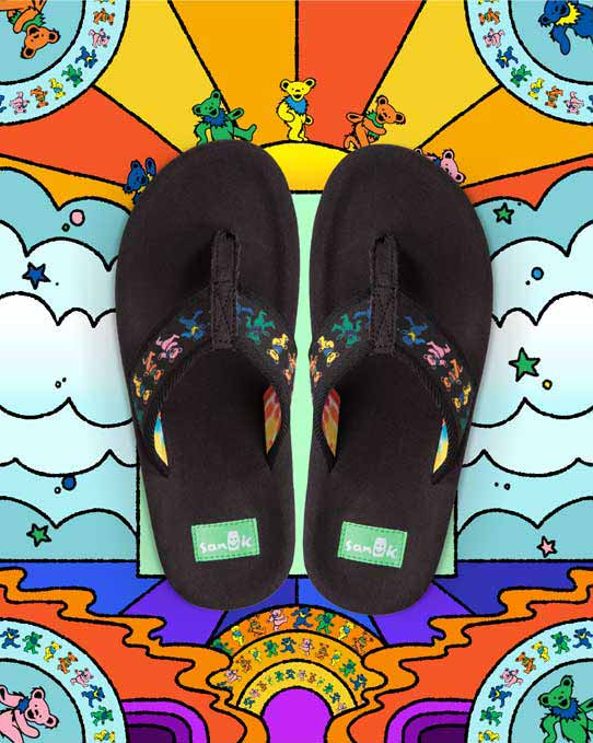 Sanuk and Grateful Dead flip-flops over warm, radiating patterns and fluffy clouds.