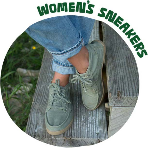 A picture of a woman standing in Sanuk sneakers