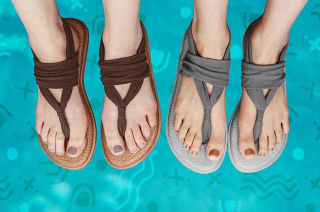 Feet wearing the Yoga sling cruz over a blue background