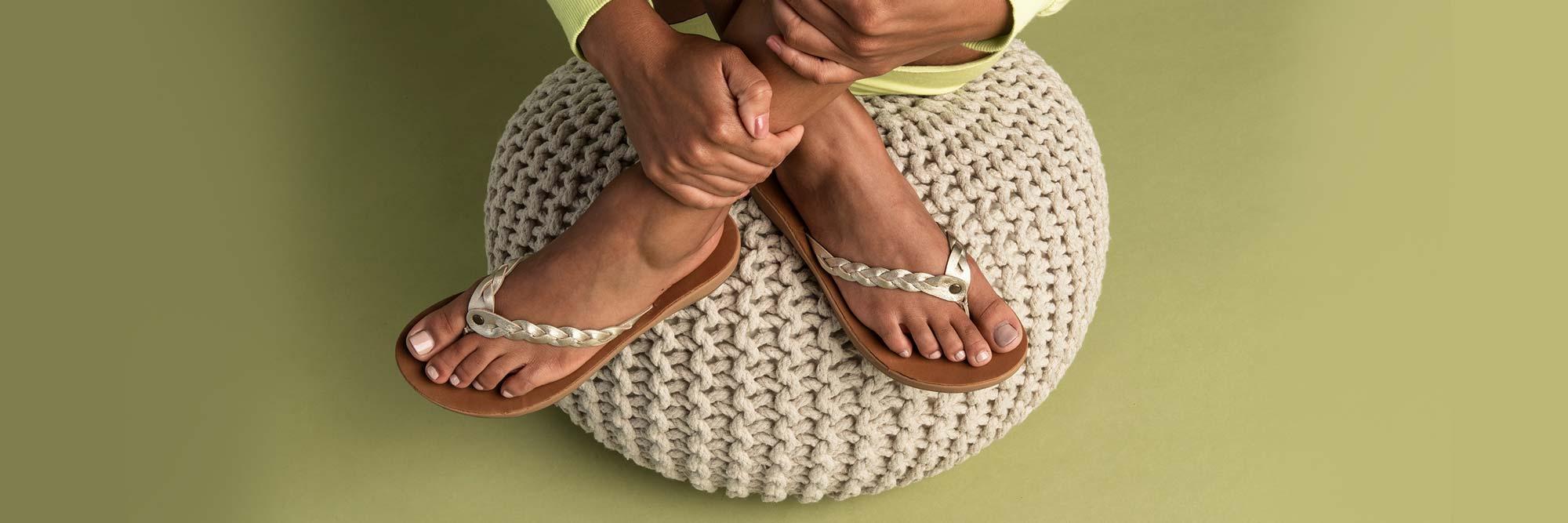 Close up of a woman's feet wearing Sanuk Sandals.