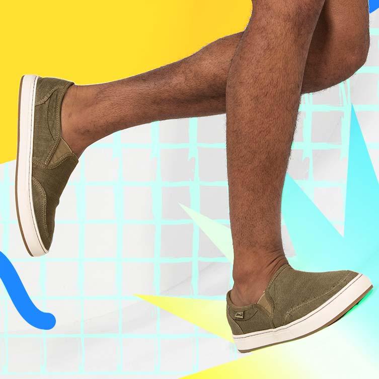 Close up of a man wearing Sanuk Tideline Hemp shoes.
