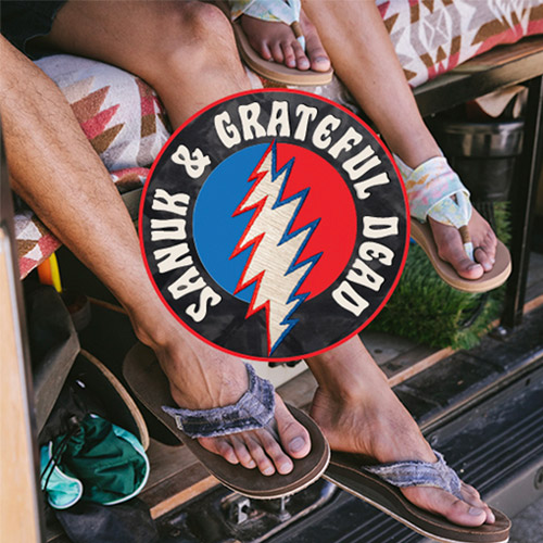 A Grateful Dead Logo with two people's feet in the background.