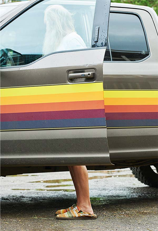 Rick Rubin standing near a truck with colored stripes.