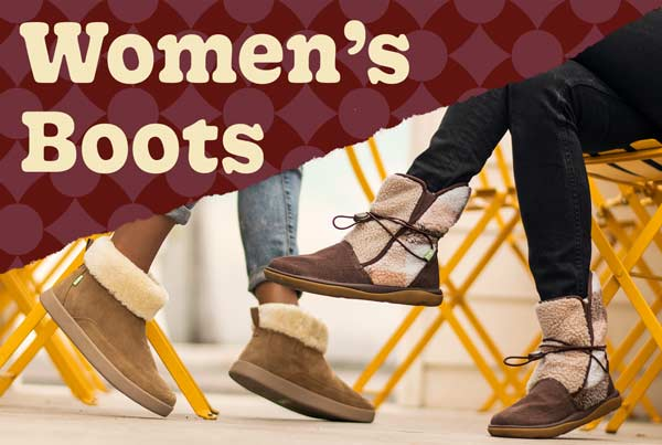 Feet wearing women's boots.