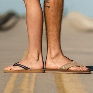 Close up of a woman wearing Sanuk Avery Hemp shoes.