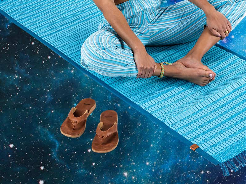 Close up of someone sitting on a rug floating over space.