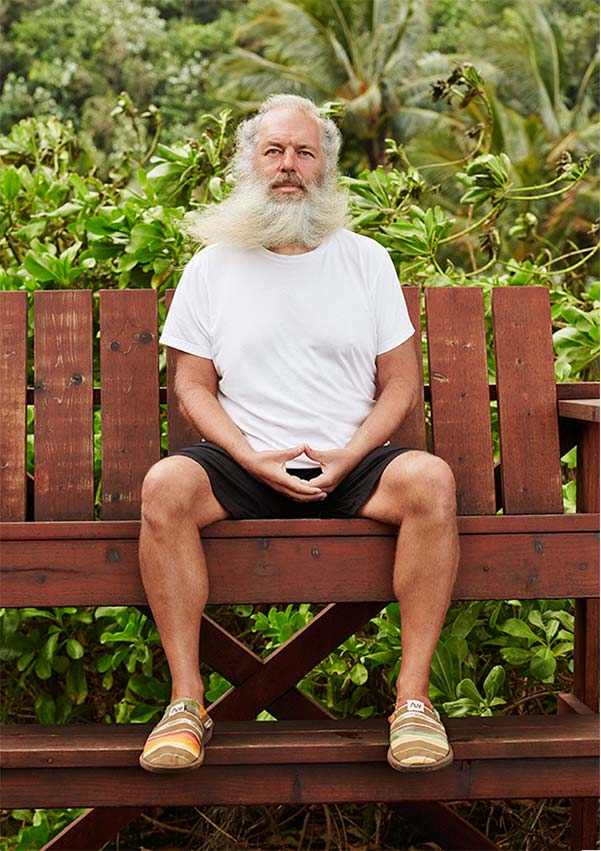 Rick Rubin sitting on a bench.