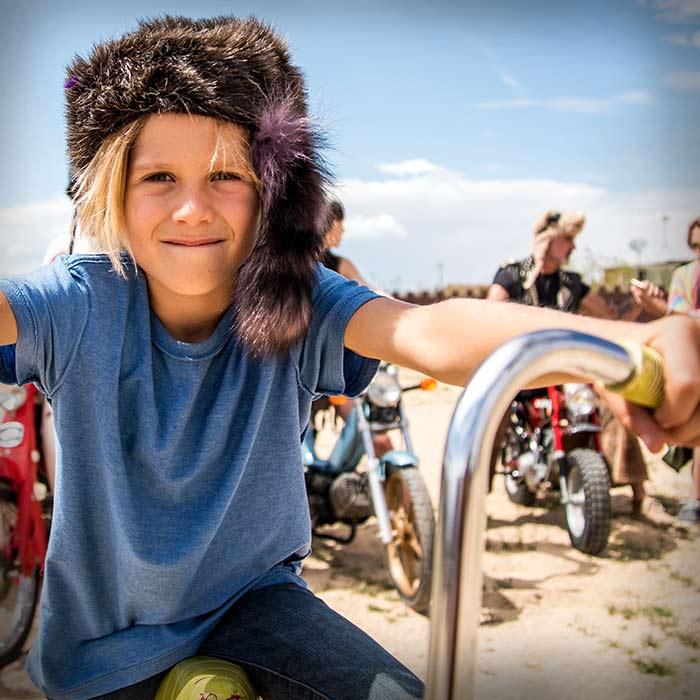 kid wearing a racoon hat