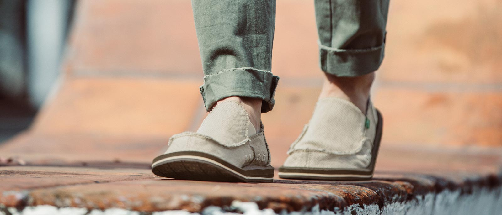 Man walking wearing Sanuks.