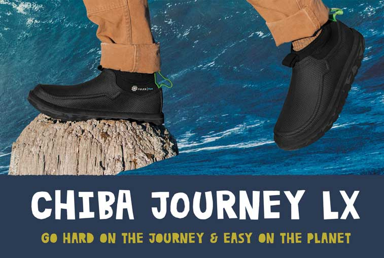 Close up of Chiba Journey LX with Paige Alms and Ramon Navarro surfing in the background. Go hard on the journey and easy on the planet.