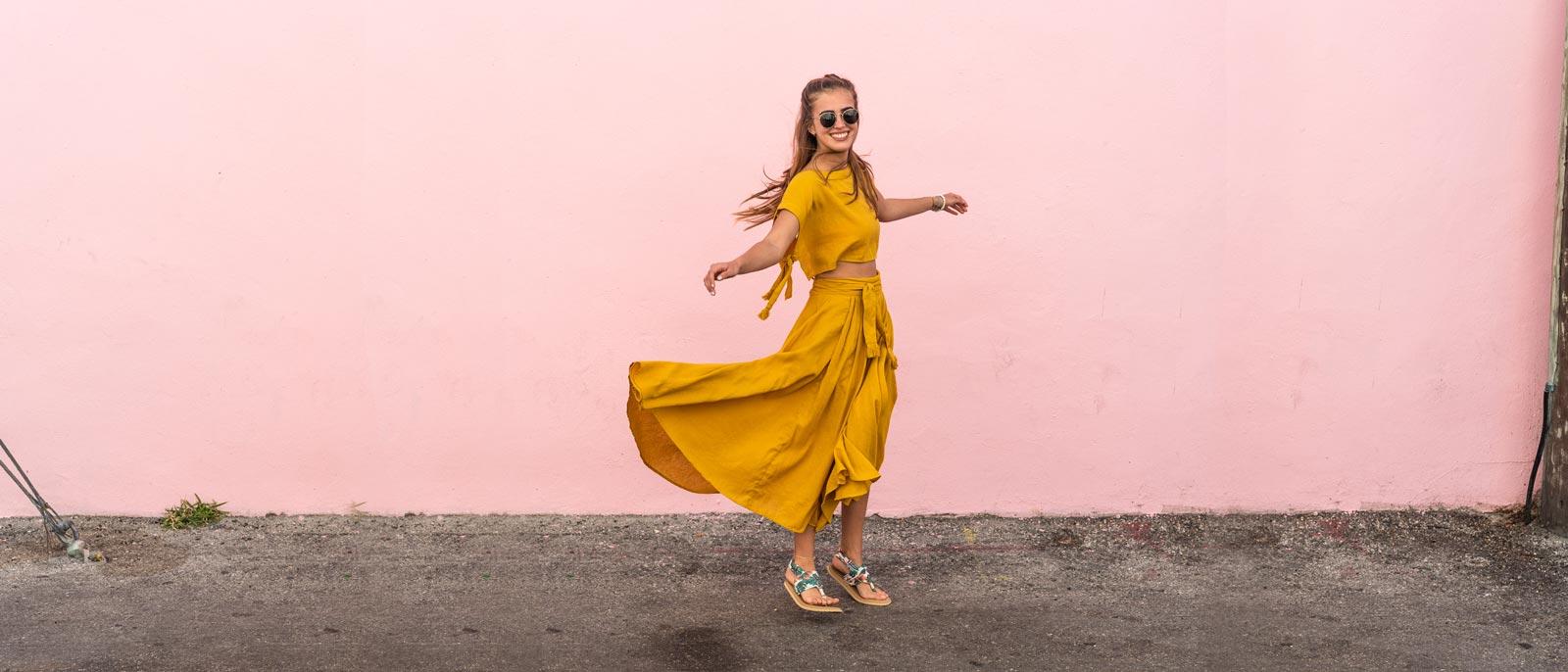 Lady in orange dress wearing Sanuk sandals.