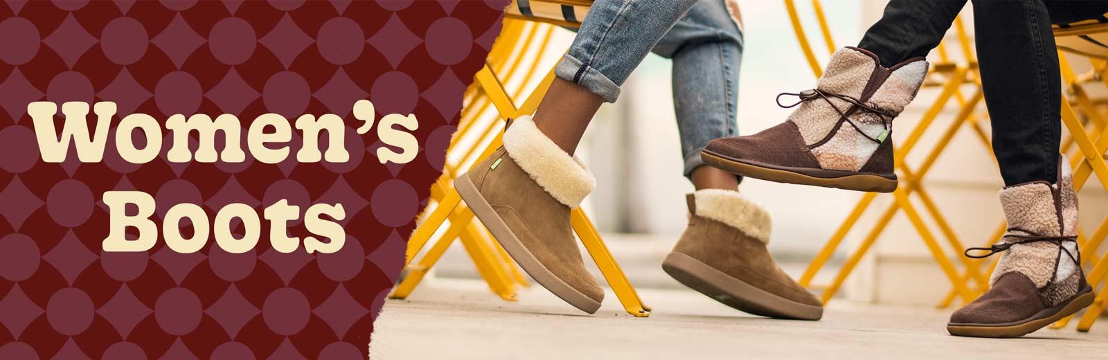 Feet wearing women's boots.