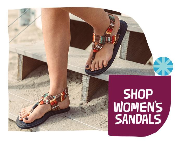 Feet walking down stairs in sandals