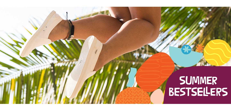 Girl jumping in white Sanuk Sneakers