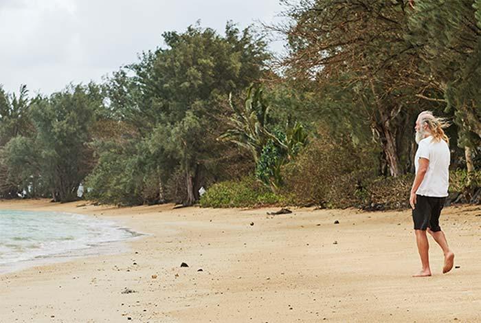 Rick Rubin walking on the beach.